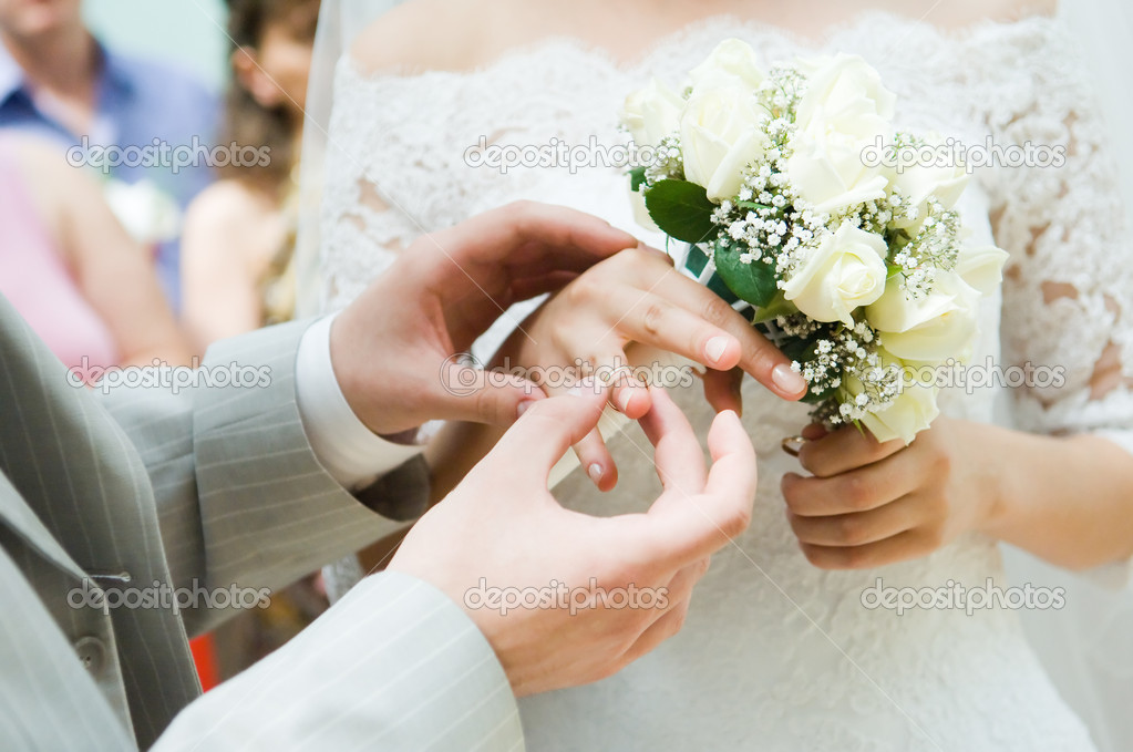 Close-up of young newly-married putting on the rings — Stock Photo #1252244