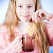 Little girl with tea cup — Stock Photo #1265568