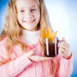 Cute little girl with tea cup — Stock Photo