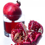Pomegranate fruits and juice — Stock Photo