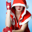 Cool girl in Santa Claus clothes — Stock Photo
