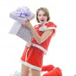Young girl in Santa Claus clothes with g — Stock Photo