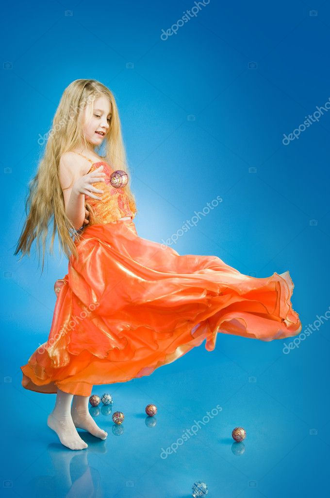 Cute little girl with holiday decorations, studio shot  Stock Photo #1266344