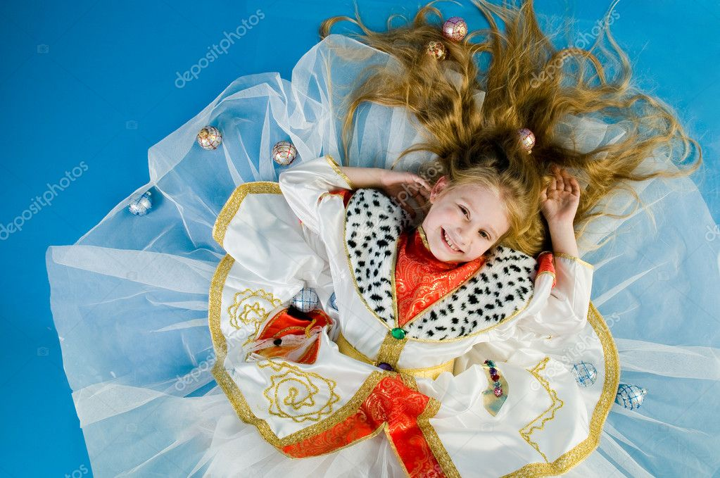 Smiling little girl in royal clothes, high angle of view  Stock Photo #1266433
