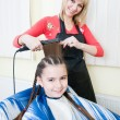Little girl getting her new haircut - Stockfoto