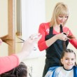 Cute little girl in hairdresser salon - Stok fotoğraf