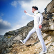 Fashionable man in white suit - Stock Photo