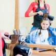 Stock Photo: Little girl in hairdresser salon