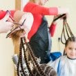 Cute girl in hairdresser salon — Stock Photo