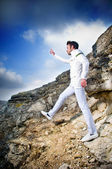 Fashionable man in white suit — Stock Photo