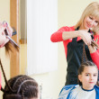 Pretty little girl in hairdresser salon — Stock Photo