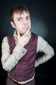 Thoughtful stylish man in vest — Stock Photo