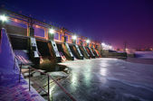 Night view of a dam — Stock Photo