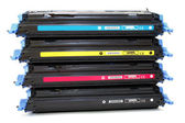 Four cartridges for laser printers — Stock Photo