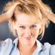 Cheerful woman with dishevelled hair — Stock Photo #1194821