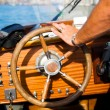 Standing at the wheel — Stockfoto