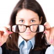 Young woman looking through eyeglasses — Stock Photo #1194863
