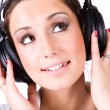 Young woman with big headphones - Stock Photo