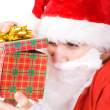 Santa Claus looking into gift box — Stock Photo