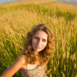 Стоковое фото: Young woman on a summer field