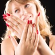 Young woman showing her red nails — Stock Photo