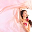 Young woman with pink fabric — Stock Photo #1195041