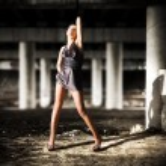 Sexy woman posing in dark industrial zon — Stock Photo