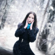Young woman in a snowstorm — Stock Photo #1195110