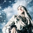 Young blond woman in a blizzard — ストック写真