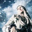 Young blond woman in a blizzard — Stockfoto