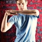 Young man dancing pose — Stock Photo #1195255