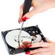 Royalty-Free Stock Photo: Woman repairing computer HDD