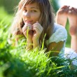 Young woman lying on grass — Stock Photo #1195399