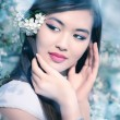 Young woman with cherry flowers — Stockfoto