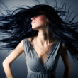 Woman with fluttering hair - Stockfoto
