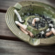Stock Photo: Ash-tray with cigarettes