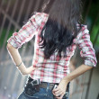 Stock Photo: Young woman with guns backside view