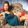 Young woman in a chair — Stockfoto