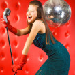 Young woman singer — Stock Photo