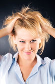 Cheerful woman with dishevelled hair — Stock Photo