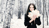 Brunette woman with maple leaves — Stock Photo
