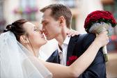 Young wedding couple kissing — Stock Photo