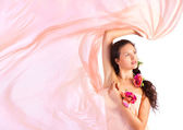 Young woman with pink fabric — Stock Photo