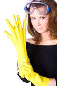 Woman worker with yellow rubber gloves — Stock Photo