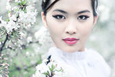Young woman with cherry flowers — Stock Photo