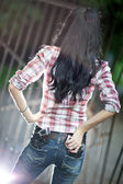 Young woman with guns backside view — Stock Photo