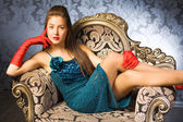 Young woman in a chair — Foto Stock