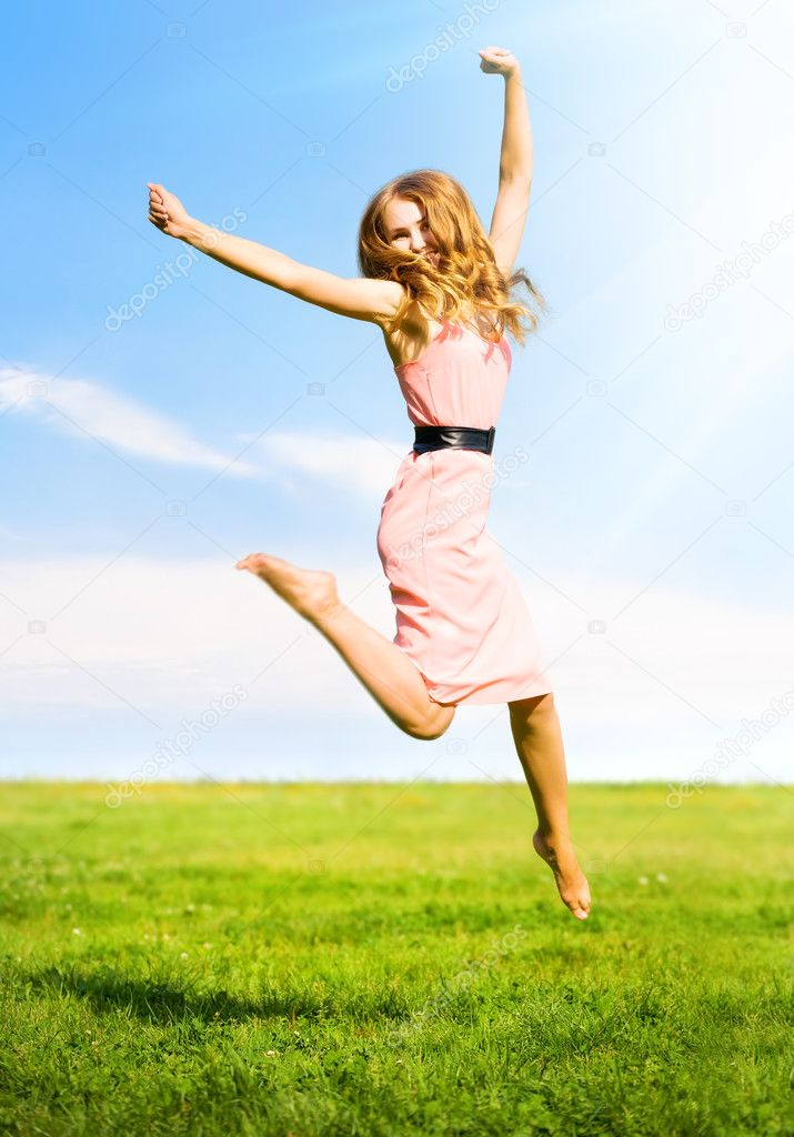 Happy jumping girl on summer field background. — Zdjęcie stockowe #1194788