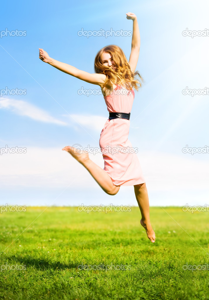 Happy jumping girl on summer field background. — Stok fotoğraf #1194788