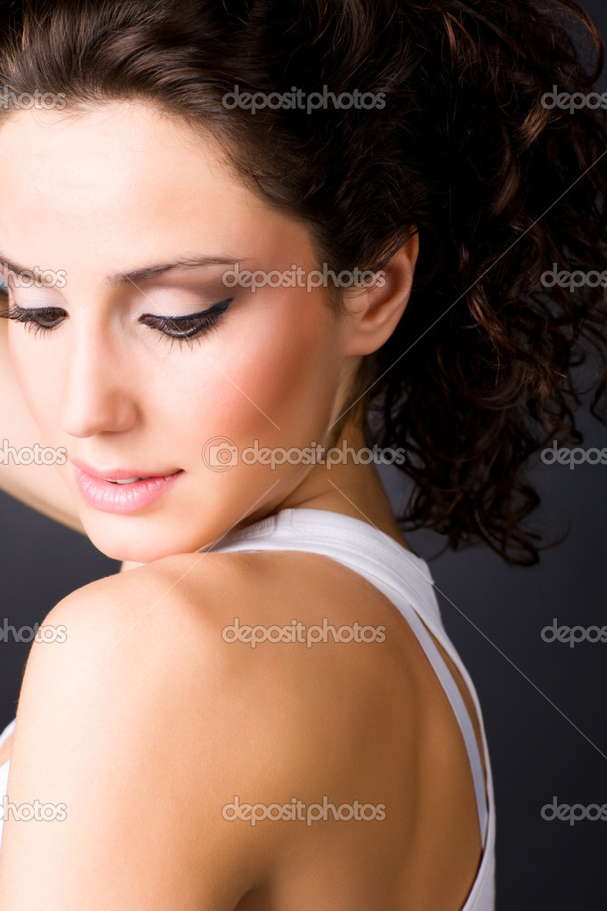 Young brunette woman portrait. On dark background. — Stock Photo #1194866